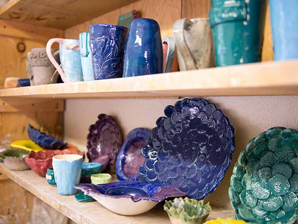 Pottery bowls, mugs, and plates made by kids