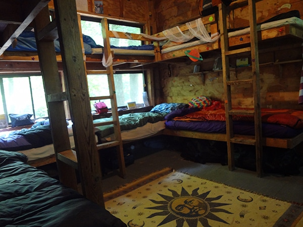 Youth girls cabin with bunk beds and sleeping bags