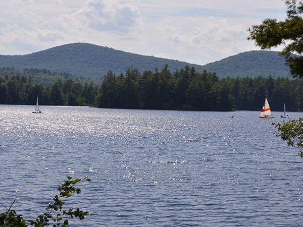 Sailing on a lake with mountain background in New England