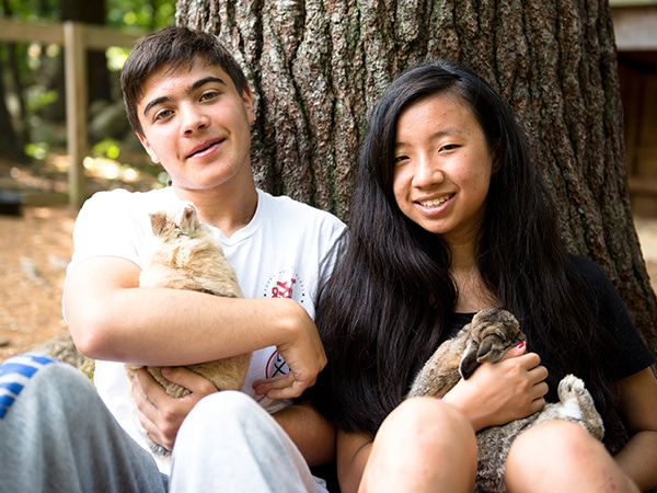 Teens on the farm with bunnies and other animals