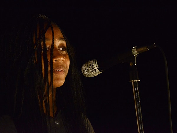 African American girl performing a song in a music festival at summer camp
