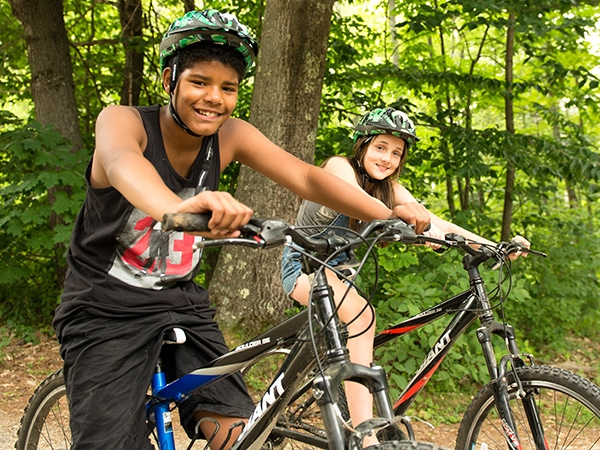 Kids mountain biking at camp