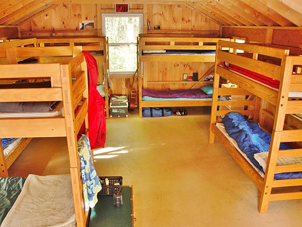 Bunk beds in summer camp housing for kids and teens