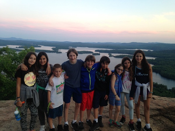 Kids hiking to mountain summit in New Hampshire