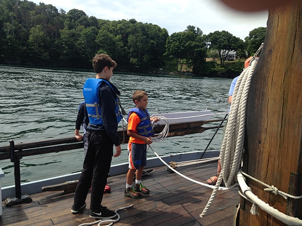 Kids learning to sail on boat in New Hampshire with adventure program