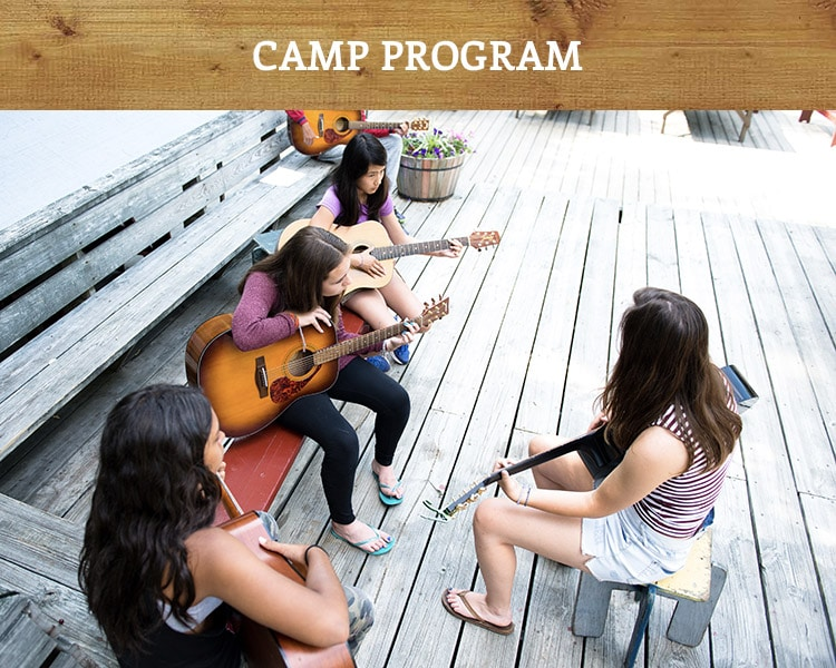 Campers participating in guitar lessons, led by Windsor Mountain counselor