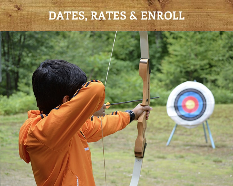 boy practicing archery at an adventurous summer camp