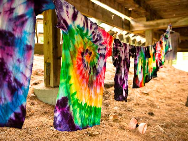 Tye-dying shirts at summer camp
