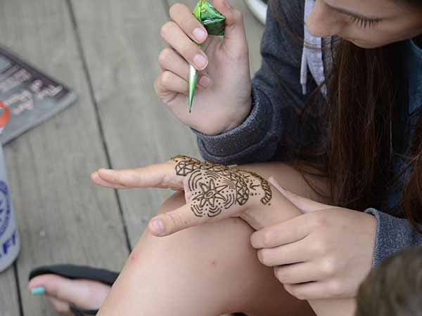 Henna tattoos at summer camp in New Hampshire