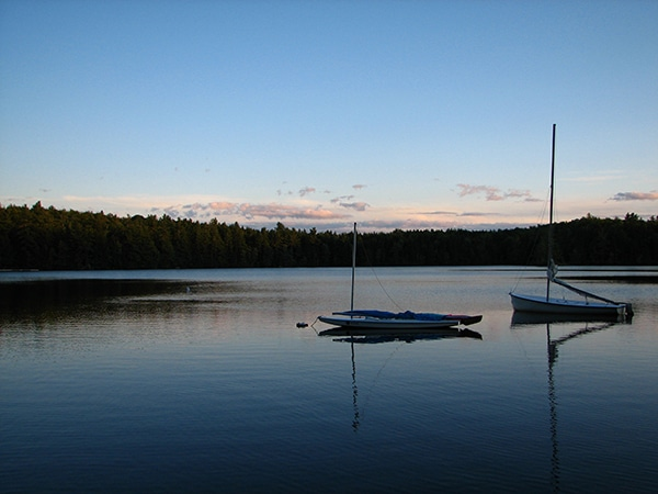 Sunset on the lake in New Hampshire with sailboats