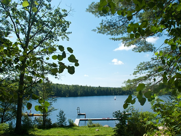 Lake vista with swimming dock, dive tour, water trampoline, and sailboats in southwestern New Hampshire