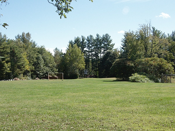 New England summer camp sports field equipped with tennis, basketball, yolleyball courts and soccer field