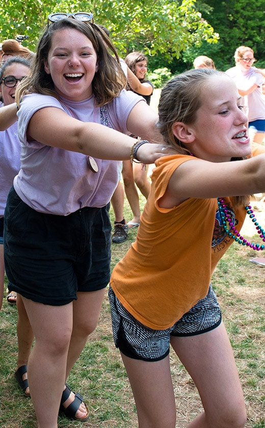 campers and counselors dancing and celebrating the final days of summer camp