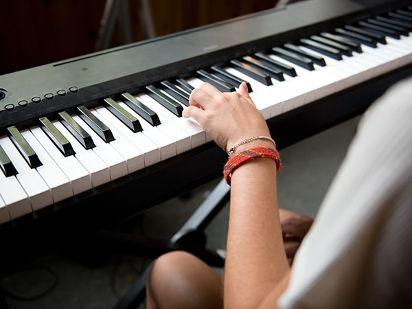 Girl playing keyboard piano