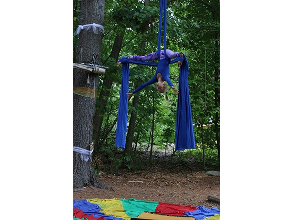 Girl performing with aerial silks at summer camp