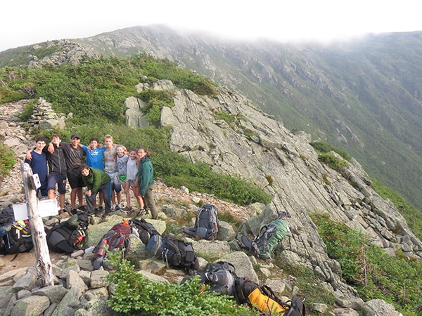 Teens with summer camp hiking on the presidential traverse in New Hampshire