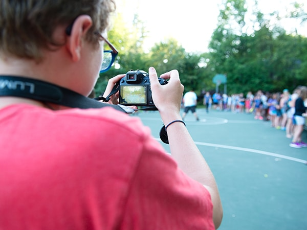 Child taking photos at summer camp