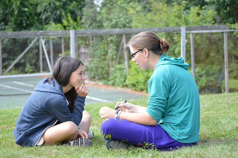 international camper at summer camp taking ELL course with counselor