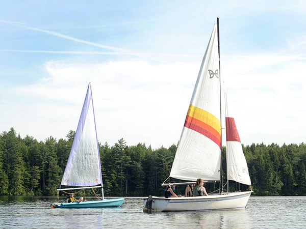 Campers sailing at summer camp in New England